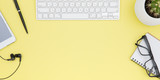 workspace with tablet, keyboard, coffee cup and eyeglasses copy space on yelow background. Top view. - 230884368
