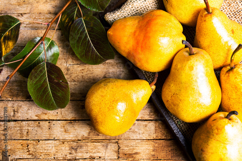 Organic pears on rustic wooden background