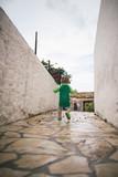 Todler walking on stony street