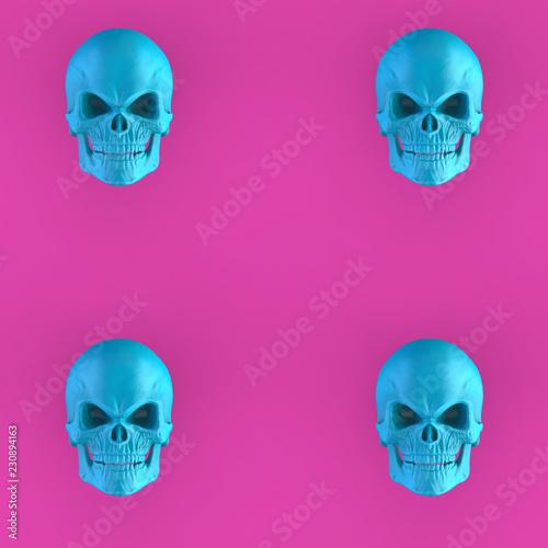 Four bright blue skulls on pink background