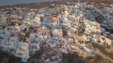 Aerial, downtown Oia in Greece - 230901110