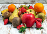 Fruits surrounded by rustic background