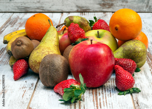 Fruits surrounded by rustic background - 230901978