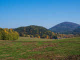 green meadow with autumn colorful forest and trees and hills before sunset landscape in luzicke lusitian hory mountain - 230902399