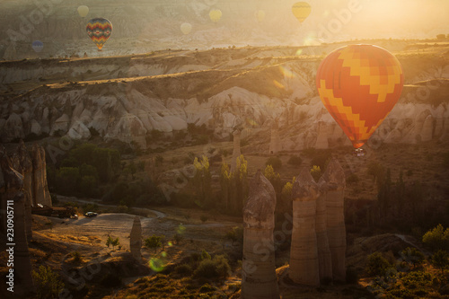 Landscaoe with colorful balloons at sunrise over love valley in Cappadocia, Turkey.