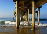 underneath ocean pier with waves crashing - 230907177