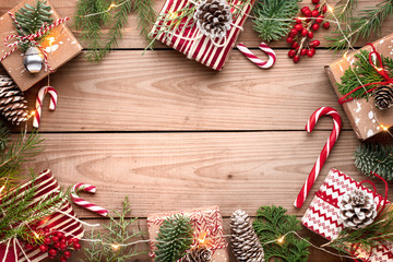 Gift boxes with fir branches on wooden background