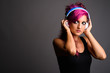 Beautiful woman with pink hair and make-up against gray backgrou