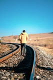 A railway track in rural Turkey. A man walking along it - 230952973