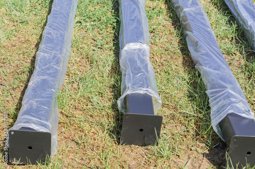 new metal piles in plastic package on construction site. Steel materials. Construction supplies - 230957388