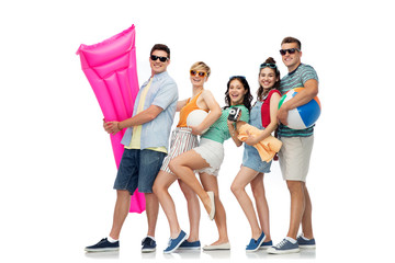 summer holidays and people concept - group of happy smiling friends in sunglasses with beach ball, volleyball, towel, camera and air mattress over white background © Syda Productions