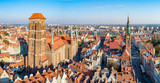 Gdansk, Poland. Panorama of old city with St Mary church, town hall tower, Dluga (Long) Street, and old historic houses.  Aerial view in sunset light