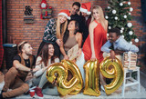 Group of Cheerful old friends communicate with each other. New 2019 Year is coming. Celebrate the new year in a cozy home atmosphere - 230966185