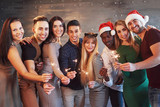 Party with friends. Group of cheerful young people carrying sparklers and champagne flutes - 230966301