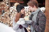 christmas happy couple in love embrace in snowy winter cold forest, copy space, new year party celebration, holiday and vacation, travel, love and relations - 230966535