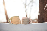 Two cups of tea on background of a winter landscape - 230966724