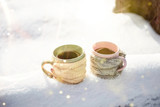Two cups of tea on background of a winter landscape - 230966740