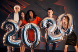 A group of beautiful young people celebrating the new year. - 230967128