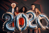 The new 2020 year is coming. Group of fun young multinational people at a party. Happy New Year - 230967159