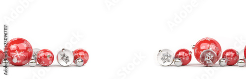 Leinwandbild Motiv Red and silver christmas baubles isolated 3D rendering