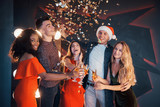 A group of friends posing and having fun with snowmen and champagne. New Year Celebration. - 230967536