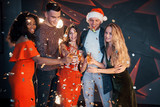 A group of friends posing and having fun with snowmen and champagne. New Year Celebration. - 230967571