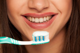 young woman holding  tooth brush with toothpaste - 230969709