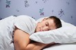 Leinwanddruck Bild - Young handsome Sleeping man in bed