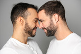 homosexual couple over a white background on studio - 231005316