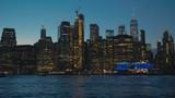 TILT UP view of New York City Manhattan downtown skyline at night. 4K UHD - 231013382