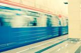 Moving train at subway station - 231041761