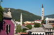 Minaret And Bell Tower In Mostar, Bosnia And Herzegovina