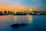 Colorful illuminations at Rainbow Bridge from Odaiba in Tokyo, Japan