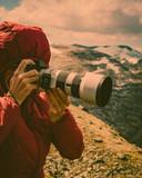 Tourist taking photo fin norwegian mountains - 231106109