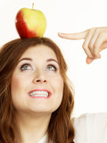Woman funny girl holds on head apple fruit