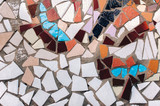 Fragment of a ceramic mosaic. An imitation of the style of Antoni Gaudi. Background, copy space. - 231110302