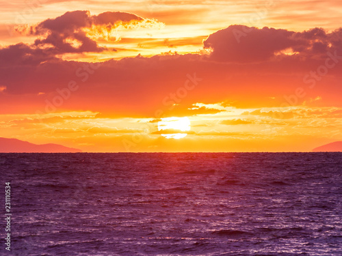Sunrise or sunset over sea surface