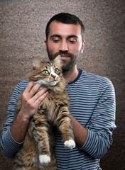 Man with Norwegian Forest Cat  © uwimages