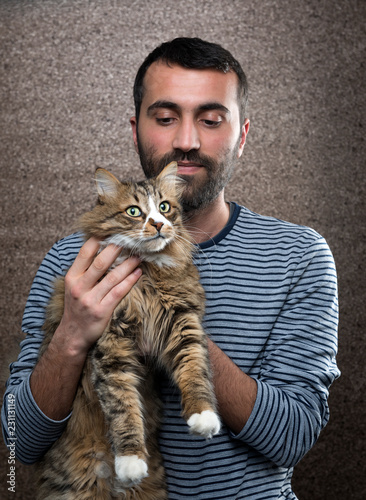 Man with Norwegian Forest Cat