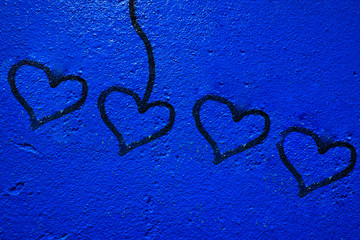 Blue painted wall background with heart signs