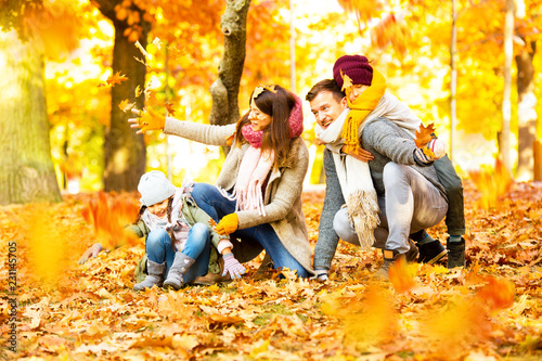 Leinwanddruck Bild family time in sunny autumn landscape