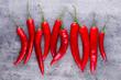 Chili cayenne pepper on grey background. - 231146116