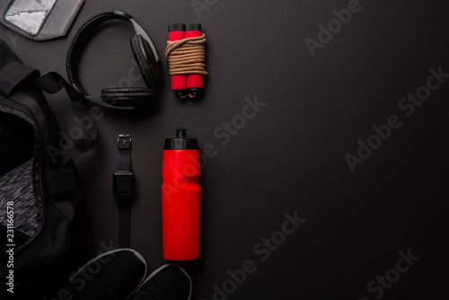elevated view of arranged composition with gym equipment isolated on black