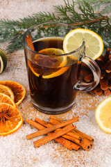 christmas tea or mulled wine on wooden table with snow  - christmas background