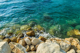 Sea water and pebbles on a sunny summer day - 231176713
