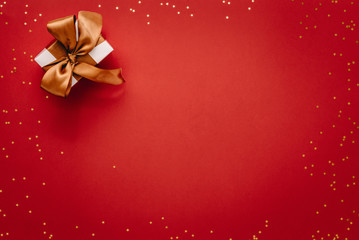 Small gift box with stars on red background. © Jacob Lund