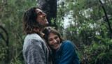 Couple having great time in forest during rain - 231190352