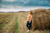 Portrait Beautiful Plus Size Young Woman Standing Near Hay Bale  - 231210963
