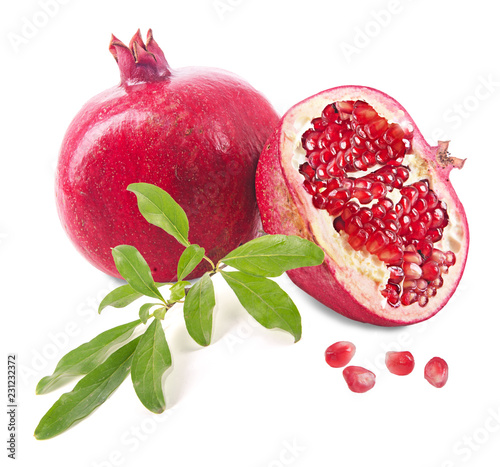 Foto Murales Pomegranate fruit and twig  isolated on white background