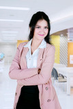 Business woman in office with folded hands - 231233118